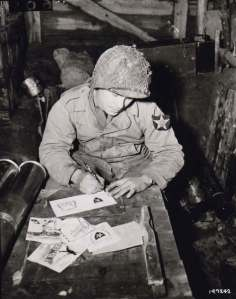 Soldier of the 2nd Infantry Division writing Christmas cards